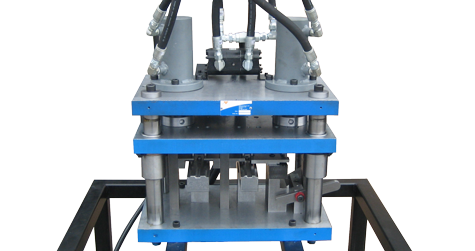 Standalone hydraulic Punch Press is responsible for a two step punching and countersinking process that creates countersunk hole punches in curtain wall aluminum mullion extrusions.